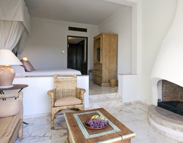 cyprus-hotels-annabelle-hotel-garden-studio-sitting-with-fireplace